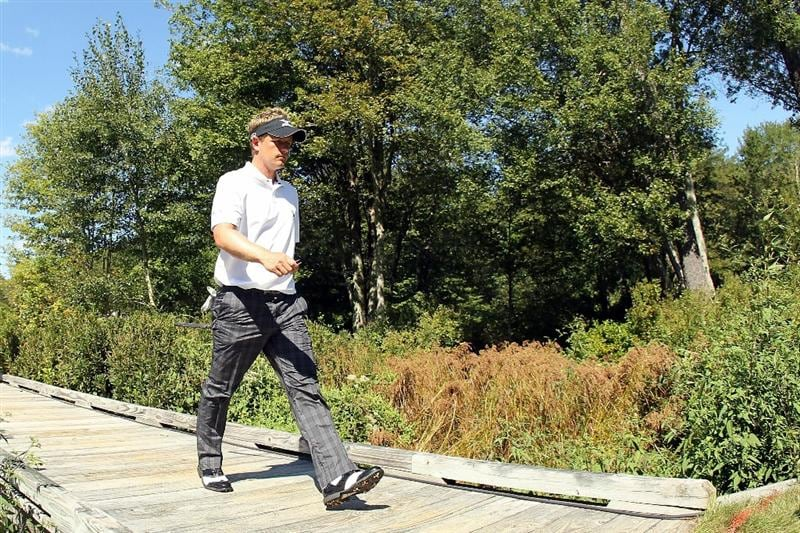 NORTON, MA - SEPTEMBER 04:  Luke Donald of England walks over the bridge on the fifth hole during the second round of the Deutsche Bank Championship at TPC Boston on September 4, 2010 in Norton, Massachusetts.  (Photo by Mike Ehrmann/Getty Images)