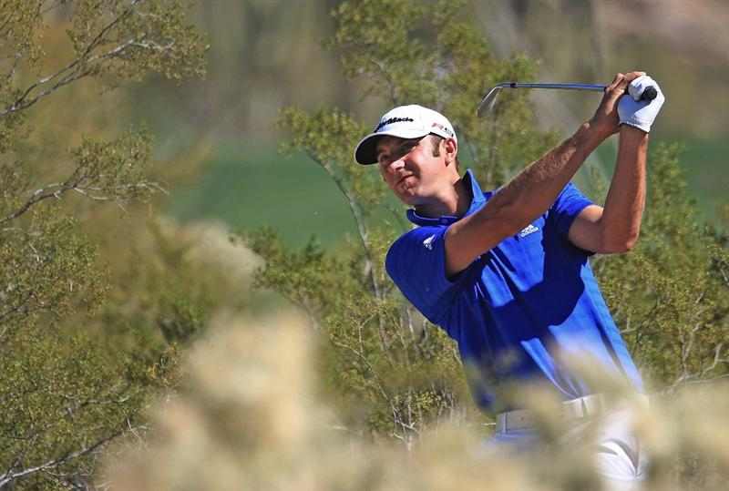 MARANA, AZ - FEBRUARY 25:  Dustin Johnson hits a shot  from the rough on the tenth hole during the first round of the Accenture Match Play Championship at the Ritz-Carlton Golf Club at Dove Mountain on February 25, 2009 in Marana, Arizona.  (Photo by Scott Halleran/Getty Images)