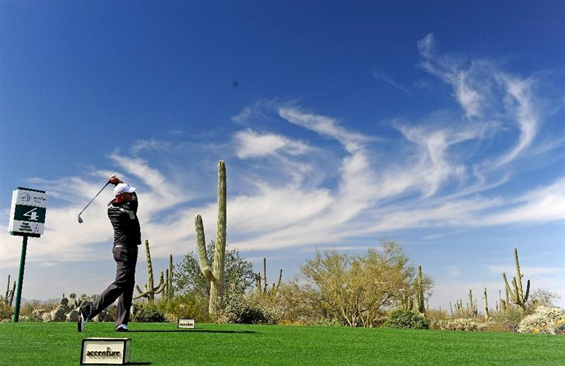 MARANA, AZ - FEBRUARY 19:  EDITORS NOTE; THIS DIGITAL PHOTOGRAPHIC IMAGE WAS CREATED WITH THE USE OF A POLARIZING FILTER. Stewart Cink plays his tee shot on the fourth hole during round three of the Accenture Match Play Championship at the Ritz-Carlton Golf Club on February 19, 2010 in Marana, Arizona.  (Photo by Stuart Franklin/Getty Images)