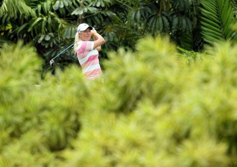 SINGAPORE - FEBRUARY 25:  Suzann Pettersen of Norway hits her tee shot on the 7th hole during the first round of the HSBC Women's Champions at Tanah Merah Country Club on February 25, 2010 in Singapore, Singapore.  (Photo by Andy Lyons/Getty Images)