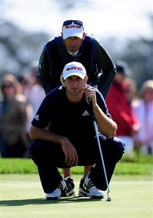 PEBBLE BEACH, CA - FEBRUARY 14:  Dustin Johnson and caddie line up a putt on the 12th hole during the final round of the AT&T Pebble Beach National Pro-Am at Pebble Beach Golf Links on February 14, 2010 in Pebble Beach, California.  (Photo by Stuart Franklin/Getty Images)