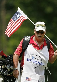 BETHESDA, MD - JULY 4: A caddie holds the American flag flagstick on the 13th hole during the second round of the AT&T National at Congressional Country Club on July 4, 2008 in Bethesda, Maryland. (Photo by Hunter Martin/Getty Images)