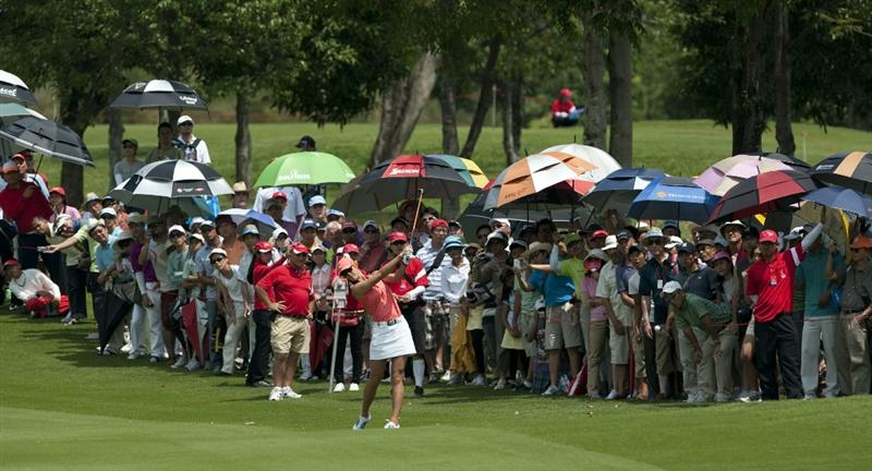 CHON BURI, THAILAND - FEBRUARY 20:  Michelle Wie of USA plays her second shot on the 1st hole during day four of the LPGA Thailand at Siam Country Club on February 20, 2011 in Chon Buri, Thailand.  (Photo by Victor Fraile/Getty Images)