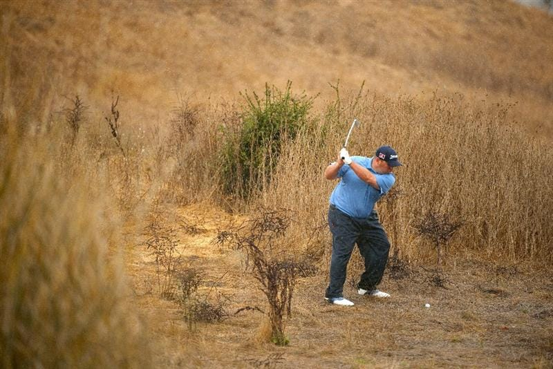 SAN MARTIN, CA - OCTOBER 17:  Kevin Stadler makes a shot out of the rough on the 12th hole during the final round of the Frys.com Open at the CordeValle Golf Club on October 17, 2010 in San Martin, California.  (Photo by Robert Laberge/Getty Images)