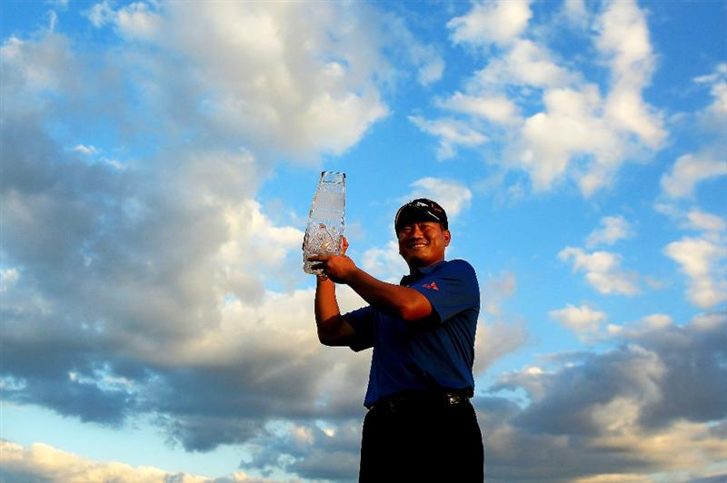 PONTE VEDRA BEACH, FL - MAY 15:  K.J. Choi of South Korea celebrates with the trophy after defeating David Toms on the first playoff hole during the final round of THE PLAYERS Championship held at THE PLAYERS Stadium course at TPC Sawgrass on May 15, 2011 in Ponte Vedra Beach, Florida.  (Photo by Streeter Lecka/Getty Images)***BESTPIX***