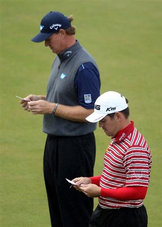VIRGINIA WATER, ENGLAND - MAY 26:  Ernie Els and Louis Oosthuizen (R) of South Africa mark their cards during the first round of the BMW PGA Championship at Wentworth Club on May 26, 2011 in Virginia Water, England.  (Photo by Warren Little/Getty Images)
