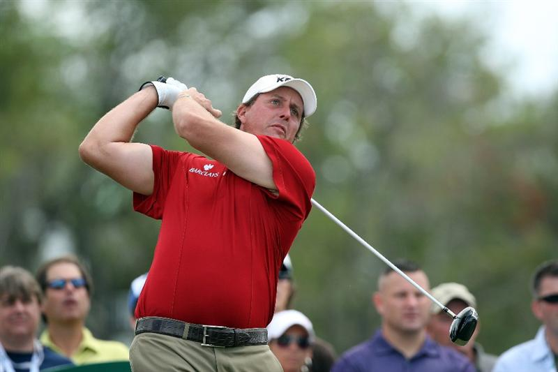 DORAL, FL - MARCH 13: Phil Mickelson of the USA tees off at the 14th hole during the second round of the World Golf Championships-CA Championship at the Doral Golf Resort & Spa on March 13, 2009 in Miami, Florida  (Photo by David Cannon/Getty Images)