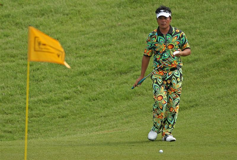 KUALA LUMPUR, MALAYSIA - MARCH 05:  Udorn Duangdecha of Thailand lines up a putt on the 14th hole during the the second round of the Maybank Malaysian Open at the Kuala Lumpur Golf and Country Club on March 5, 2010 in Kuala Lumpur, Malaysia.  (Photo by Andrew Redington/Getty Images)