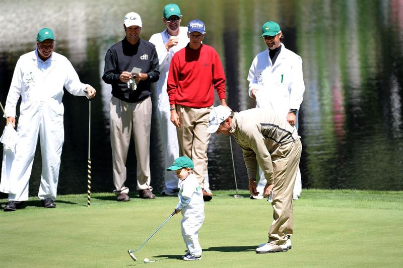 AUGUSTA, GA - APRIL 08:  Trevor Immelman of South Africa with his son Jacob alongside Paul Azinger and Larry Mize during the Par 3 Contest prior to the 2009 Masters Tournament at Augusta National Golf Club on April 8, 2009 in Augusta, Georgia.  (Photo by Harry How/Getty Images)