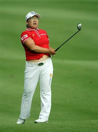 SINGAPORE - FEBRUARY 28:  Jiyai Shin of South Korea hits her second shot on the sixth hole during the final round of the HSBC Women's Champions at the Tanah Merah Country Club on February 28, 2010 in Singapore.  (Photo by Andrew Redington/Getty Images)