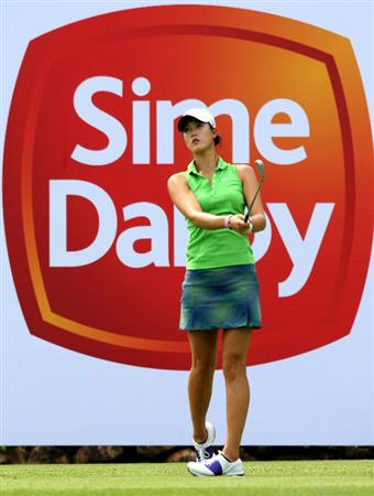 KUALA LUMPUR, MALAYSIA - OCTOBER 21:  Michelle Wie of USA plays her tee shot on the 10th hole during the Sime Darby Pro-Am at the KLGCC Golf Course on October 21, 2010 in Kuala Lumpur, Malaysia.  (Photo by Stanley Chou/Getty Images)