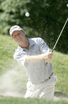Wes Short Jr. blasts from a bunker on the 5th hole during the first round of the 2005 John Deere Championship at the TPC at Deere Run in Silvis, Michigan on Thursday, July 7, 2005.Photo by Sam Greenwood/WireImage.com