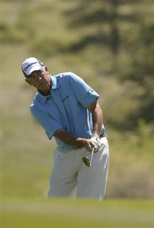 PARKER, CO. - MAY 30: Tom Lehman hits his approach shot into the 1st hole during the fourth and final round of the 71st Senior PGA Championship at the Colorado Golf Club on May 30, 2010 in Parker, Colorado.  (Photo by Marc Feldman/Getty Images)
