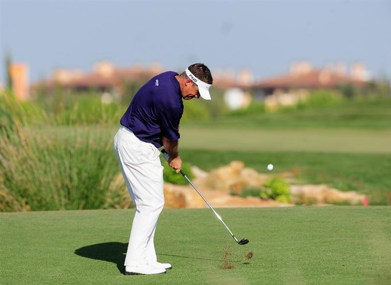VILAMOURA, PORTUGAL - OCTOBER 17:  Lee Westwood of England plays his approach shot on the 14th hole during the third round of the Portugal Masters at the Oceanico Victoria Golf Course on October 17, 2009 in Vilamoura, Portugal.  (Photo by Stuart Franklin/Getty Images)