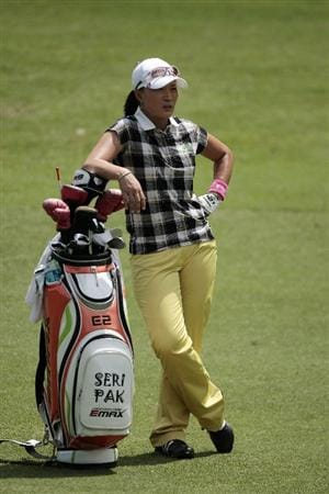MOBILE, AL - MAY 14:  Se Ri Pak of South Korea leans on her bag in the ninth fairway during second round play in the Bell Micro LPGA Classic at the Magnolia Grove Golf Course on May 14, 2010 in Mobile, Alabama.  (Photo by Dave Martin/Getty Images)