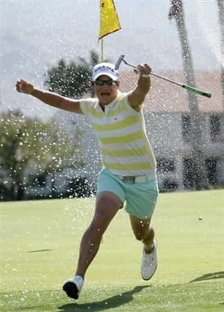 RANCHO MIRAGE, CA - APRIL 04:  Champion Yani Tseng of Taiwan runs as Morgan Pressel sprays her with champagne on the 18th green after the final round of the Kraft Nabisco Championship at Mission Hills Country Club on April 4, 2010 in Rancho Mirage, California.  (Photo by Stephen Dunn/Getty Images)