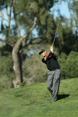 LA JOLLA, CA - JANUARY 28:  Bill Haas hits his second shot on the seventh hole during round two of the Farmers Insurance Open at Torrey Pines South Course on January 28, 2011 in La Jolla, California.  (Photo by Stephen Dunn/Getty Images)
