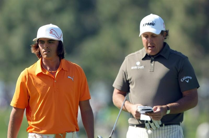 LA JOLLA, CA - JANUARY 29:  Rickie Fowler and Phil Mickelson look on the 6th green during Round 3 of the Farmers Insurance Open at Torrey Pines on January 29, 2011 in La Jolla, California. (Photo by Donald Miralle/Getty Images)