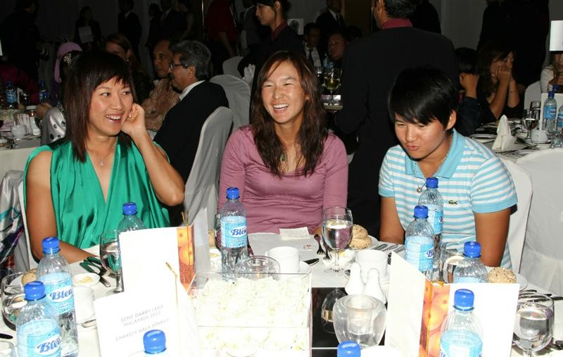 KUALA LUMPUR, MALAYSIA - OCTOBER 22 : Yani Tseng ( L ), Candie Kung ( C ) and Amy Hung during the Sime LPGA Charity Gala Dinner on October 22, 2010 at the Sime Darby Convention Centre in Kuala Lumpur, Malaysia. (Photo by Stanley Chou/Getty Images)