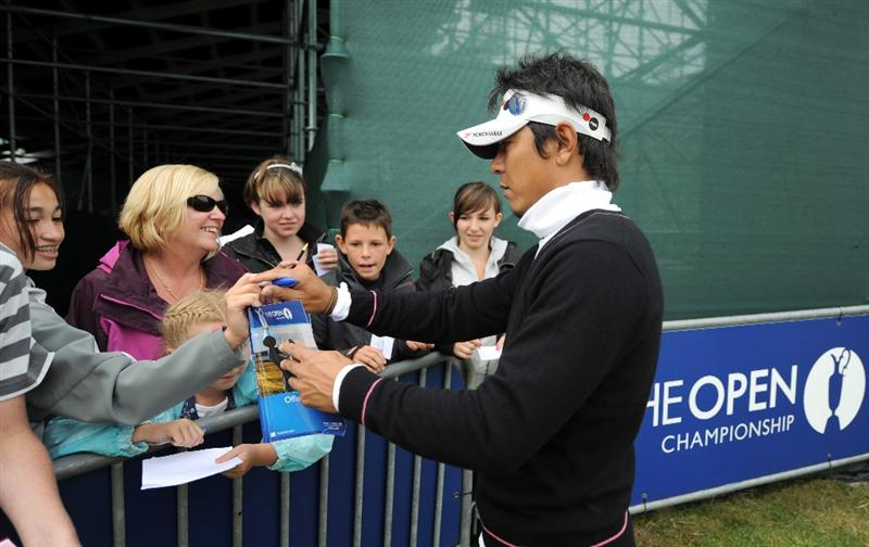 TURNBERRY, UNITED KINGDOM - JULY 12: Tomohiro Kondo of Japan signs autographs for the spectators during the practice round of the 138th Open Championship on July 12, 2009 on the Ailsa Course, Turnberry Golf Club, Turnberry, Scotland. (Photo: Harry How/Getty Images)
