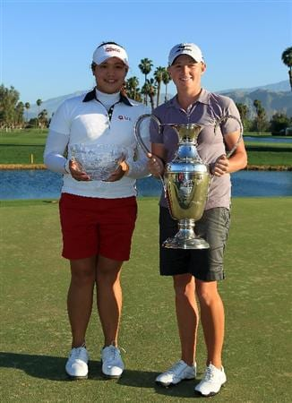 RANCHO MIRAGE, CA - APRIL 03:  Stacy Lewis of the USA proudly holds the trophy with Ariya Jutanugarn of Thailand who is holding the trophy for the leading amateur after the final round of the 2011 Kraft Nabisco Championship on the Dinah Shore Championship Course at the Mission Hills Country Club on April 3, 2011 in Rancho Mirage, California.  (Photo by David Cannon/Getty Images)