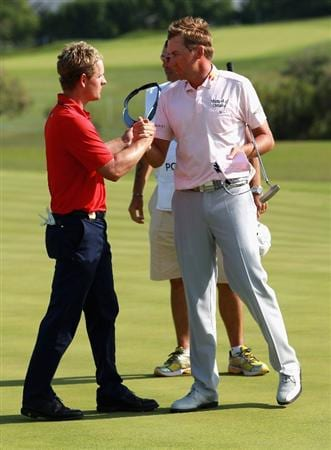 CASARES, SPAIN - MAY 22:  Ian Poulter of England is congratulated by Luke Donald of England after winning the Volvo World Match Play Championship at Finca Cortesin on May 22, 2011 in Casares, Spain.  (Photo by Andrew Redington/Getty Images)