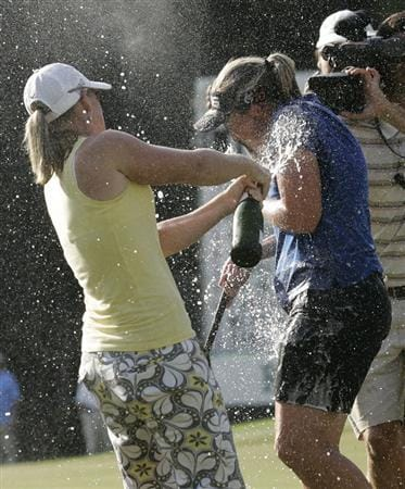 MOBILE, AL - SEPTEMBER 14:  Angela Stanford, right, is doused with champagne after winning the Bell Micro LPGA Classic at Magnolia Grove Golf Course on September 14, 2008 in Mobile, Alabama.  (Photo by Dave Martin/Getty Images)