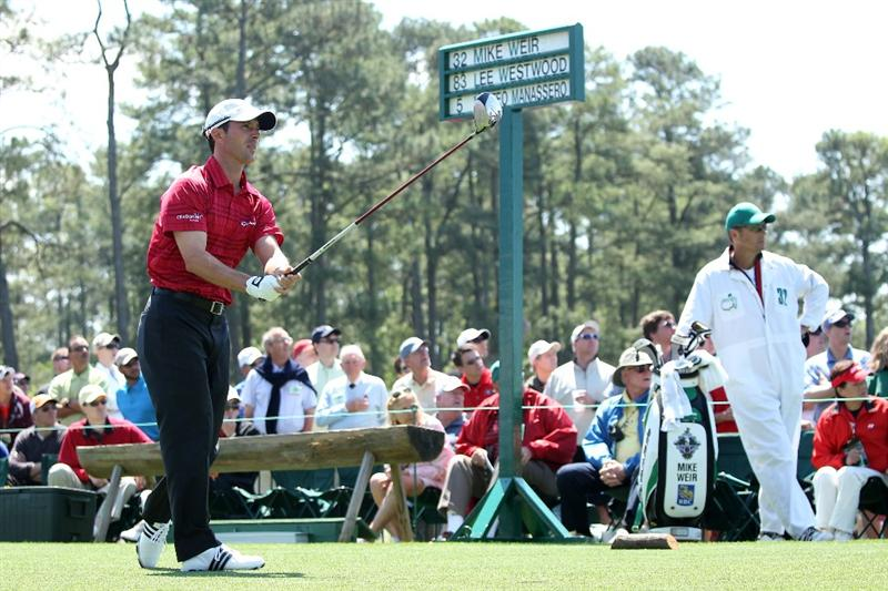 AUGUSTA, GA - APRIL 09:  Mike Weir of Canada watches his tee shot on the first hole as his caddie Brennan Little looks on during the second round of the 2010 Masters Tournament at Augusta National Golf Club on April 9, 2010 in Augusta, Georgia.  (Photo by Andrew Redington/Getty Images)