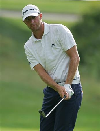 NORTON, MA - SEPTEMBER 05:  Dustin Johnson of the United States hits a chip shot during the second round of the Deutsche Bank Championship at TPC Boston held on September 5, 2009 in Norton, Massachusetts.  (Photo by Michael Cohen/Getty Images)