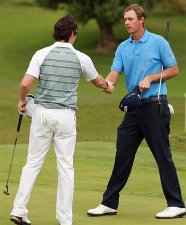 CASARES, SPAIN - MAY 20:  Nicolas Colsaerts of Belgium (right) shakes hands with Rory McIlroy of Northern Ireland after winning their match during the group stages of the Volvo World Match Play Championship at Finca Cortesin on May 20, 2011 in Casares, Spain.  (Photo by Andrew Redington/Getty Images)