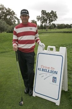 Dana Quigley poses with the persimmon driver used to promote the 'Drive To A Billion' campaign Wednesday October 26, during the 2005 Schwab Cup Championship at Sonoma Golf Club - Sonoma, California.Photo by Chris Condon/PGA TOUR/WireImage.com