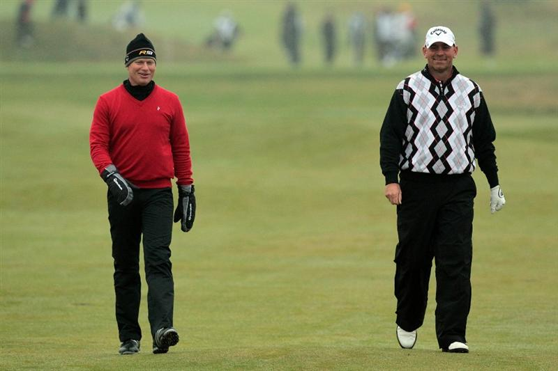 CARNOUSTIE, SCOTLAND - OCTOBER 08:  Thomas Bjorn of Denmark with his playing partner Peter Hedblom of Sweden at the 6th hole during the second round of The Alfred Dunhill Links Championship at Carnoustie Golf Links on October 8, 2010 in Carnoustie, Scotland.  (Photo by David Cannon/Getty Images)