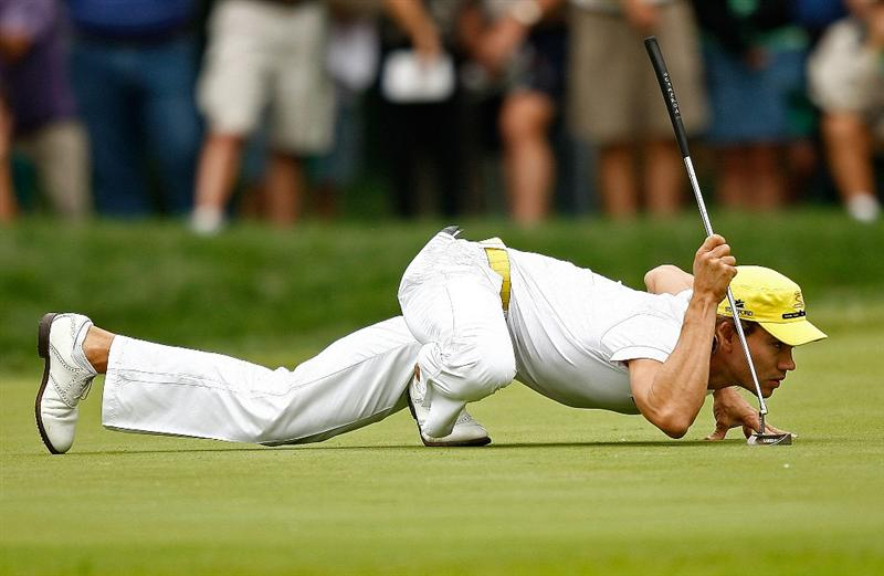 ST. LOUIS - SEPTEMBER 07: Camilo Villegas lines up a putt on the 4th hole during the final round of the BMW Championship on September 7, 2008 at Bellerive Country Club in St. Louis, Missouri.  (Photo by Mike Ehrmann/Getty Images)
