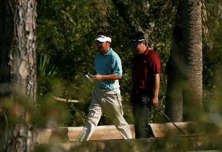 PORT SAINT LUCIE, FL - OCTOBER 28:  Daisuke Maruyama (L) of Japan and Charlie Wi of South Korea walk together on the eighth hole during the final round of the Ginn Sur Mer Classic at Tesoro Resort October 28, 2007 in Port Saint Lucie, Florida.  (Photo by Doug Benc/Getty Images)