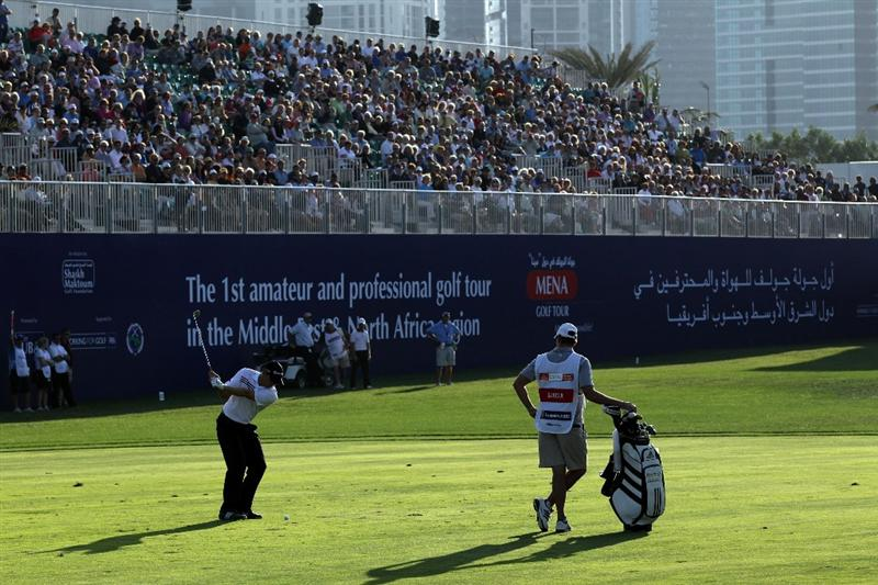 DUBAI, UNITED ARAB EMIRATES - FEBRUARY 12:  Sergio Garcia of Spain plays his third shot on the 18th hole during the third round of the 2011 Omega Dubai Desert Classic on the Majilis Course at the Emirates Golf Club on February 12, 2011 in Dubai, United Arab Emirates.  (Photo by David Cannon/Getty Images)