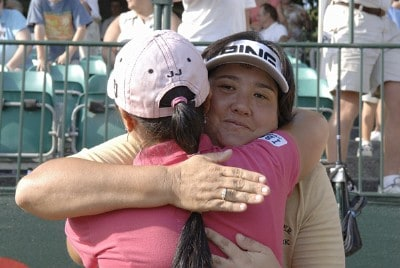 Winner Pat Hurst hugs runner-up Jeong Jang on the 18th green after the final round of the Safeway Classic at Columbia-Edgewater Country Club in Portland, Oregon on August 20, 2006.Photo by Al Messerschmidt/WireImage.com