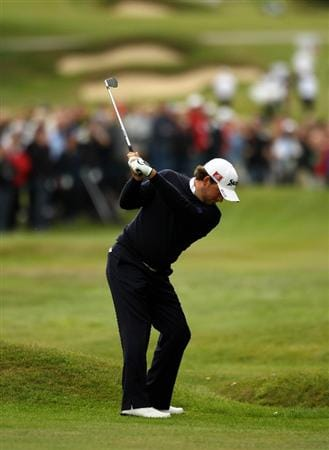 VIRGINIA WATER, ENGLAND - MAY 27:  Graeme McDowell of Northern Ireland hits an approach shot on the 15th hole during the second round of the BMW PGA Championship at the Wentworth Club on May 27, 2011 in Virginia Water, England.  (Photo by Richard Heathcote/Getty Images)