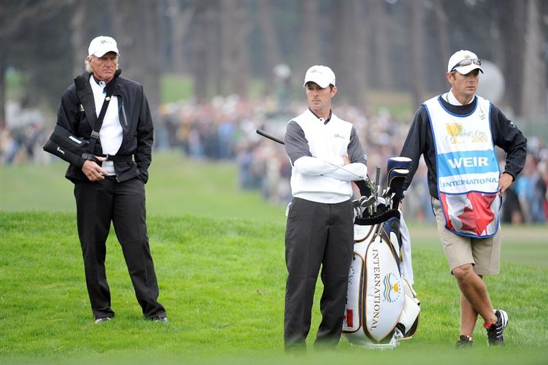 SAN FRANCISCO - OCTOBER 10:  Captain Greg Norman and Mike Weir of the International Team wait from the rough on the 18th hole during the Day Three Morning Foursome Matches of The Presidents Cup at Harding Park Golf Course on October 10, 2009 in San Francisco, California.  (Photo by Harry How/Getty Images)