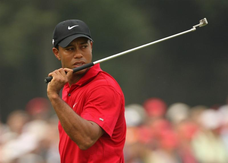SHANGHAI, CHINA - NOVEMBER 08:  Tiger Woods of the USA looks dejected on the second green during the final round of the WGC - HSBC Champions at Sheshan International Golf Club on November 8, 2009 in Shanghai, China.  (Photo by Ross Kinnaird/Getty Images)