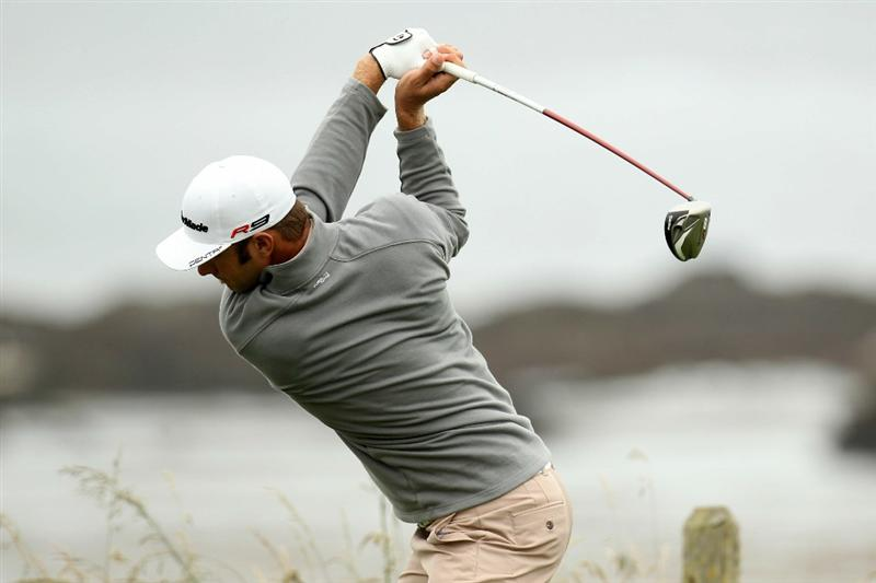 PEBBLE BEACH, CA - JUNE 15:  Dustin Johnson hits a tee shot during a practice round prior to the start of the 110th U.S. Open at Pebble Beach Golf Links on June 15, 2010 in Pebble Beach, California.  (Photo by Ross Kinnaird/Getty Images)