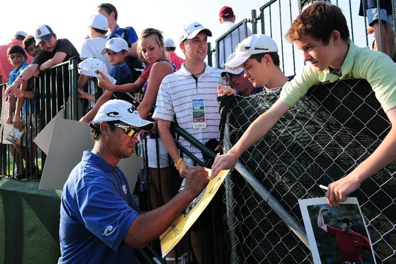 CHASKA, MN - AUGUST 11:  Michael Campbell of New Zealand signs his autograph for fans during the second preview day of the 91st PGA Championship at Hazeltine National Golf Club on August 11, 2009 in Chaska, Minnesota.  (Photo by Stuart Franklin/Getty Images)