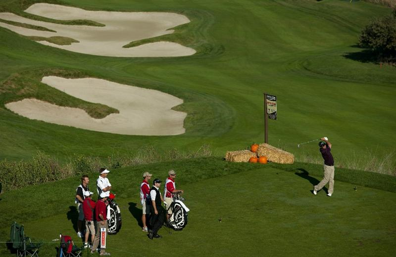 SAN MARTIN, CA - OCTOBER 15:  Cameron Beckman (R) makes a tee shot on the seventh hole as Stuart Appleby (4L) of Australia and Ben Curtis (3R) look on during the second round of the Frys.com Open at the CordeValle Golf Club on October 15, 2010 in San Martin, California.  (Photo by Robert Laberge/Getty Images)