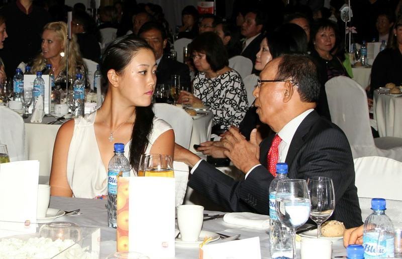 KUALA LUMPUR, MALAYSIA - OCTOBER 22 : Michelle Wie and Sime Darby Chairman Tun Musa Hitam during the  Sime Darby LPGA Charity Gala Dinner on October 22, 2010 at the Sime Darby Convention Centre in Kuala Lumpur, Malaysia. (Photo by Stanley Chou/Getty Images)
