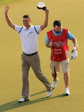 ABU DHABI, UNITED ARAB EMIRATES - JANUARY 23:  Martin Kaymer of Germany celebrates on the 18th green as his caddie Craig Connelly looks on after winning The Abu Dhabi HSBC Golf Championship at Abu Dhabi Golf Club on January 23, 2011 in Abu Dhabi, United Arab Emirates.  (Photo by Andrew Redington/Getty Images)
