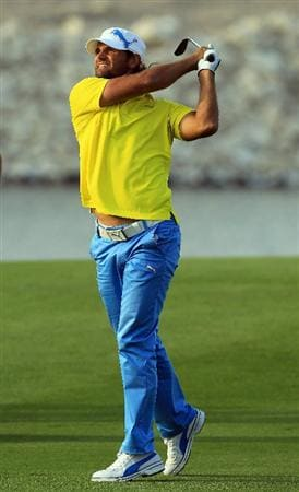 BAHRAIN, BAHRAIN - JANUARY 30:  Johan Edfors of Sweden plays his second shot at the 18th hole during the final round of the 2011 Volvo Champions held at the Royal Golf Club on January 30, 2011 in Bahrain, Bahrain.  (Photo by David Cannon/Getty Images)