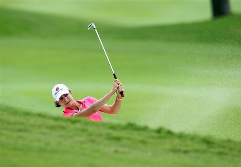 SINGAPORE - FEBRUARY 25:  Lorena Ochoa of Mexico hits her second shot on the 7th hole during the first round of the HSBC Women's Champions at Tanah Merah Country Club on February 25, 2010 in Singapore, Singapore.  (Photo by Andy Lyons/Getty Images)