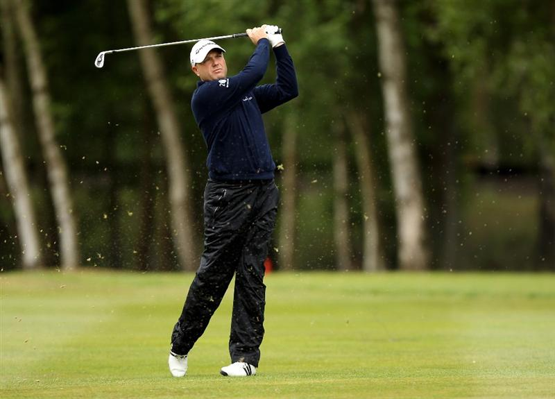 VIRGINIA WATER, ENGLAND - MAY 27:  Graeme Storm of England hits his 2nd shot on the 9th hole during the second round of the BMW PGA Championship at the Wentworth Club on May 27, 2011 in Virginia Water, England.  (Photo by Ian Walton/Getty Images)