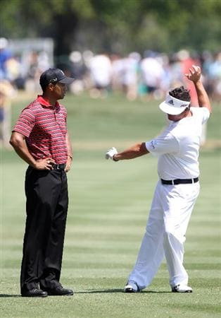 ORLANDO, FL - MARCH 27:  Tiger Woods (L) talks with Pat Perez on the 9th hole during the final round of the Arnold Palmer Invitational presented by MasterCard at the Bay Hill Club and Lodge on March 27, 2011 in Orlando, Florida.  (Photo by Sam Greenwood/Getty Images)