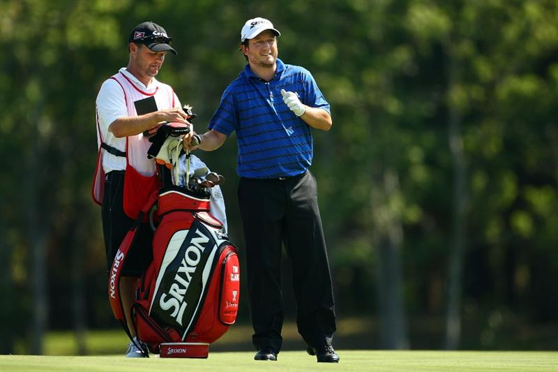 PONTE VEDRA BEACH, FL - MAY 08:  Tim Clark of South Africa (R) talks with his caddie on the 14th hole during the second round of THE PLAYERS Championship on THE PLAYERS Stadium Course at TPC Sawgrass on May 8, 2009 in Ponte Vedra Beach, Florida.  (Photo by Richard Heathcote/Getty Images)