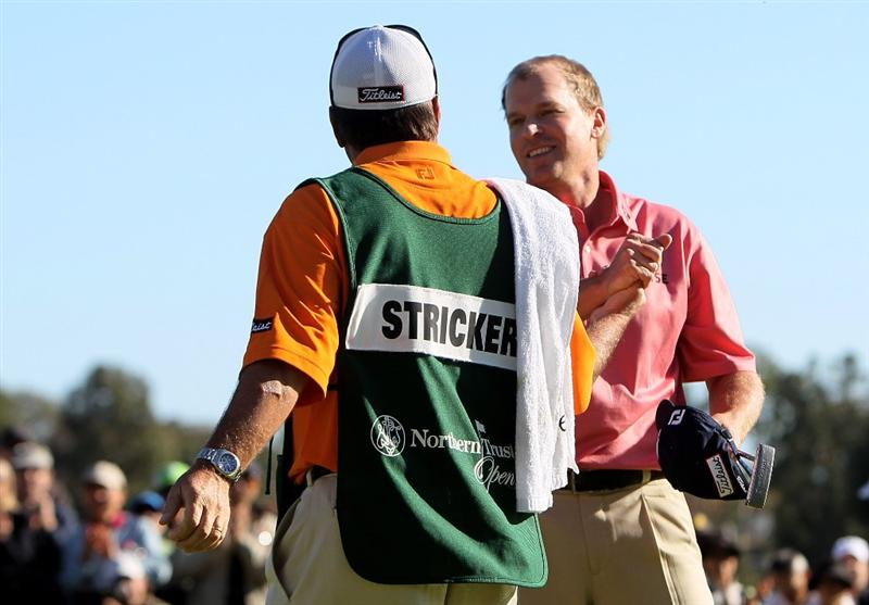 PACIFIC PALISADES, CA - FEBRUARY 07: Steve Stricker celebtrates with caddie Jimmy Johnson after winning the Northern Trust Open at Riviera Country Club on February 7, 2010 in Pacific Palisades, California. (Photo by Jeff Gross/Getty Images)